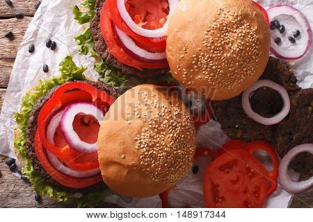 Sandwiches: Black Bean Burgers And Fresh Vegetables Close-up. Horizontal Top View