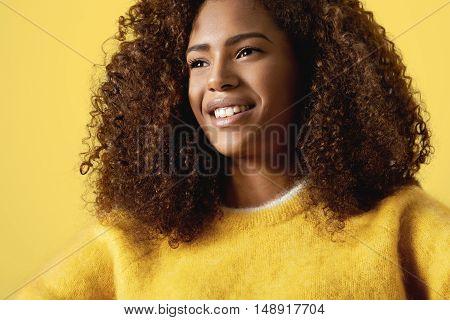 happy smiling black woman's warm yellow portrait