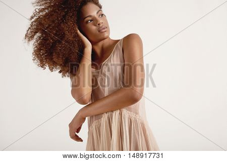 Woman With Big Curly Afro Hair Watchig Aside