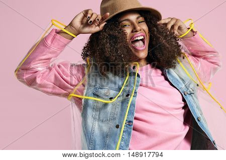 Super Bright Colored Image Of Black Woman Wears Clothes For Rain