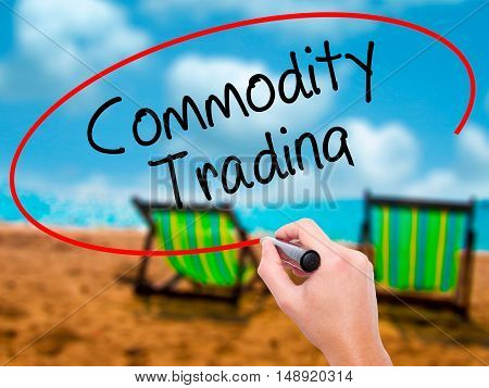 Man Hand Writing Commodity Trading With Black Marker On Visual Screen.