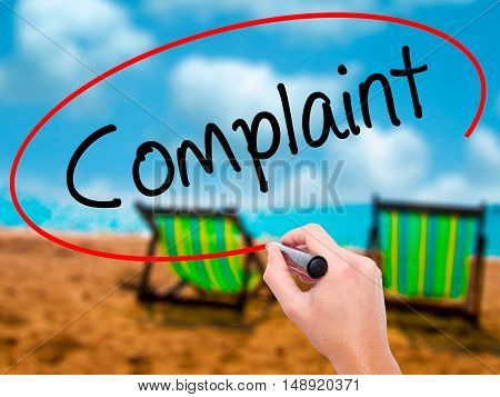 Man Hand Writing Complaint With Black Marker On Visual Screen