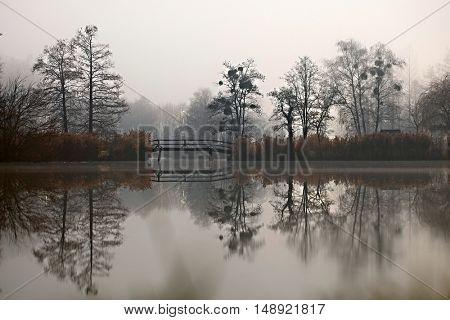 Dark autumn park with pond