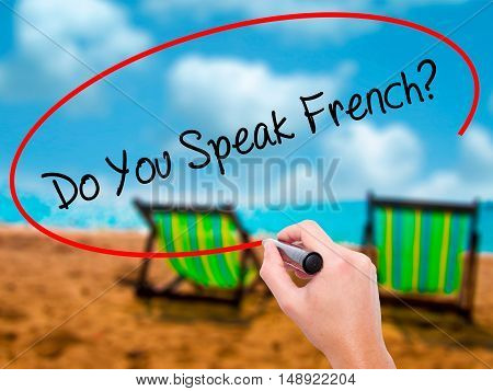 Man Hand Writing Do You Speak French?  With Black Marker On Visual Screen