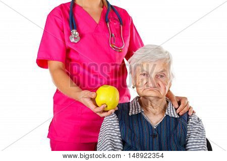 Picture of a happy senior woman visiting the doctor