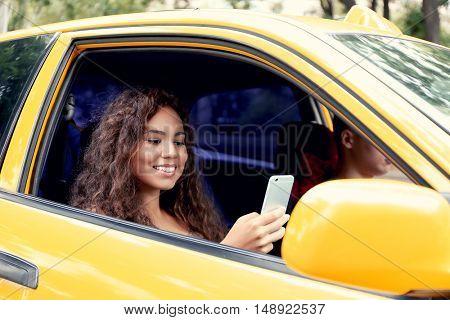 Beautiful girl in taxi car