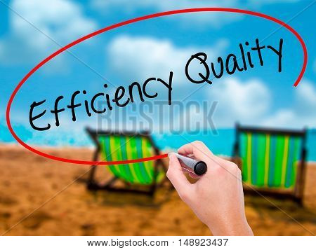 Man Hand Writing Efficiency Quality  With Black Marker On Visual Screen.