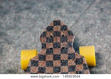 closeup longboard wheels standing on granite pavene