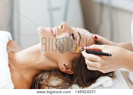 Picture of woman with facial mask in beauty salon