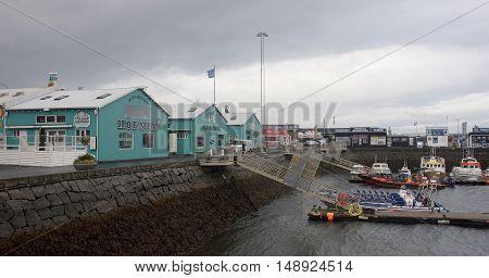 REYKJAVIK ICELAND - SEPTEMBER 15 2016: old harbour on 15 September 2016 in Reykjavik Iceland. On the waterfront there are many restaurants and tourist agencies