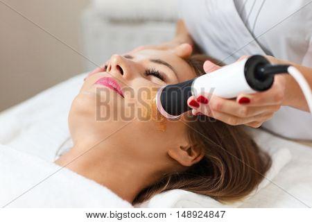 Picture of woman having facial peeling in beauty salon