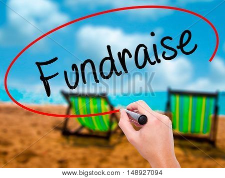 Man Hand Writing Fundraise With Black Marker On Visual Screen