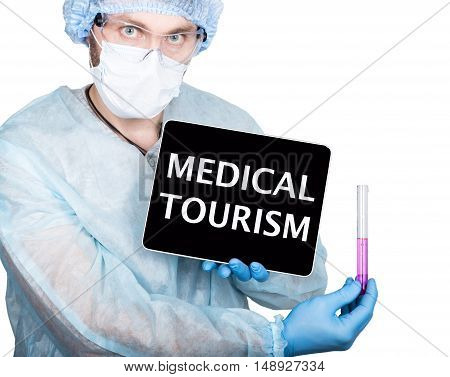 professional medical doctor showing tablet pc and medical tourism sign a display, isolated on white.