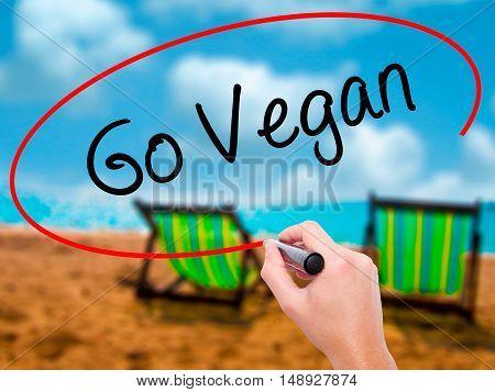 Man Hand Writing Go Vegan With Black Marker On Visual Screen