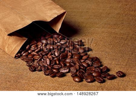 coffee beans in a bag of kraft paper on the table