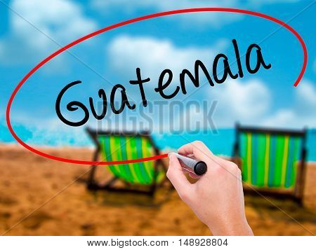 Man Hand Writing Guatemala  With Black Marker On Visual Screen