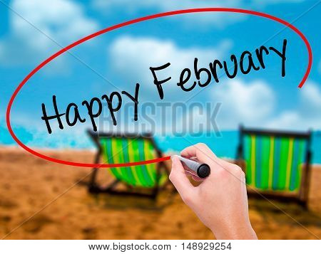 Man Hand Writing Happy February With Black Marker On Visual Screen