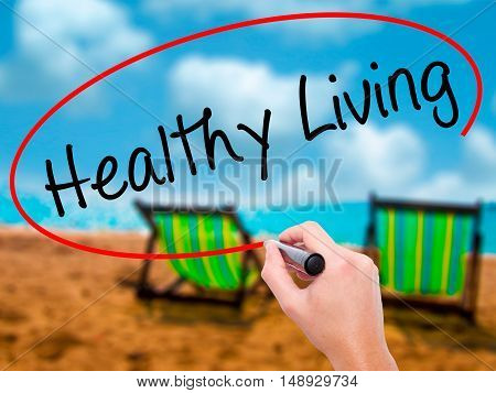 Man Hand Writing Healthy Living  With Black Marker On Visual Screen