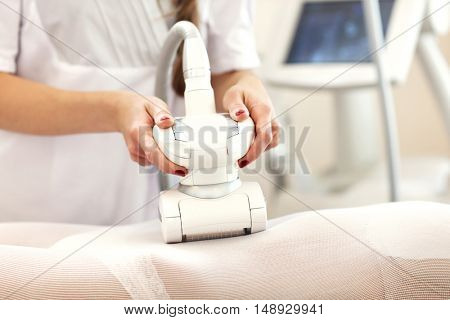 Picture of woman having abdominal treatment in beauty salon