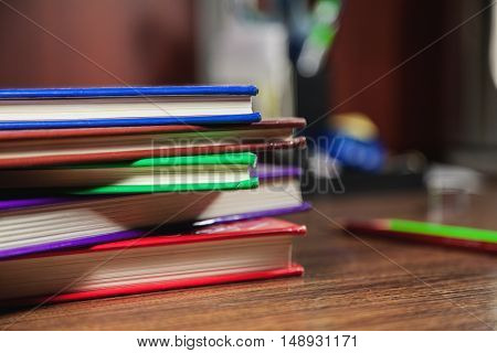 Different Color Books On Dark Wooden Table