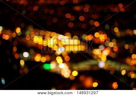 bright and warm night lights of big city not in focus