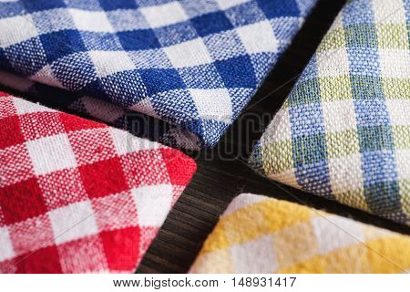 Colored Checkered Tablecloths On Wooden Table