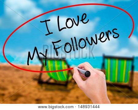 Man Hand Writing I Love My Followers With Black Marker On Visual Screen.