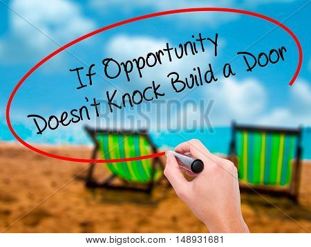 Man Hand Writing If Opportunity Doesn't Knock Build A Door With Black Marker On Visual Screen