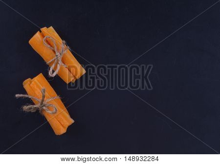 Carrot Sticks On A Black Background. Two Handful Of Carrot Sticks Tied With On Black Background.