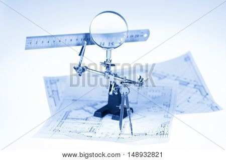 architecture blueprint -  house plans, magnifying glass, ruler & compass