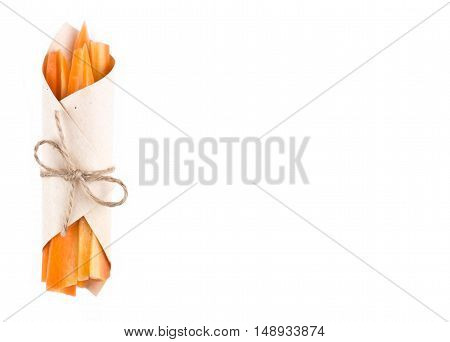 Carrot Sticks Packed Isolated Background. Carrot Sticks Wrapped In Paper And Tied With On White Back