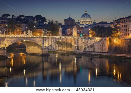 Rome. View of Vittorio Emanuele Bridge and the St. Peter's cathedral in Rome, Italy at night.