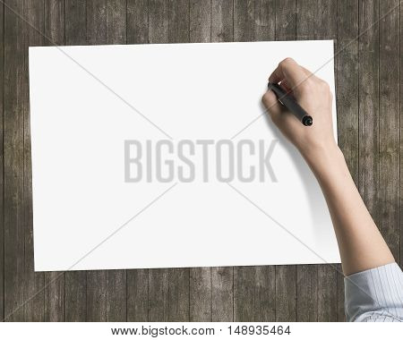 Woman's Hand Holding Pen Writing On Blank White Paper