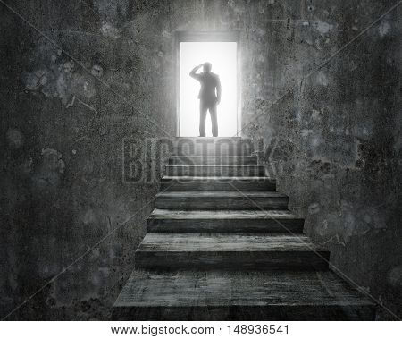 Businessman Standing On Top Of Stairs With Open Door