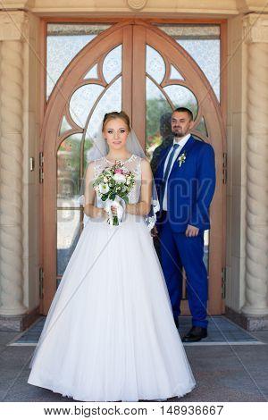 Newlyweds on a walk in a summer day wedding