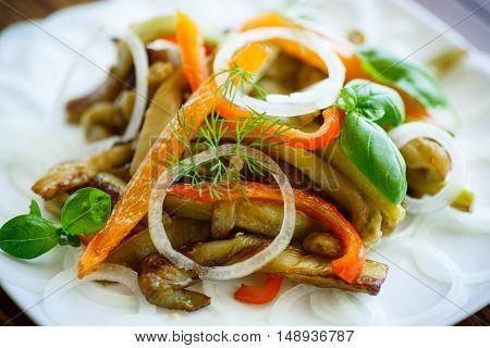 warm salad of roasted eggplant with peppers and onions