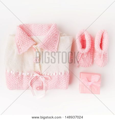 Socks and cloth-pants for baby newborn on white background. Children apparel concept.
