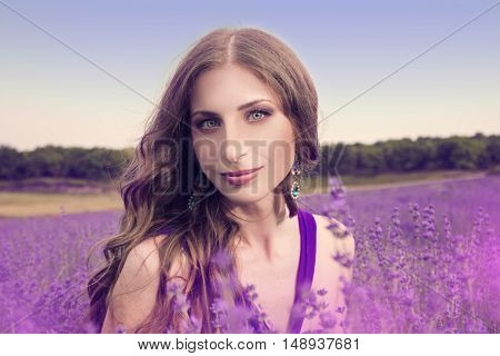 Young Woman With Long Blonde Hair In A Purple Dress Enjoying The Beauty Of Nature In The Lavender Fi