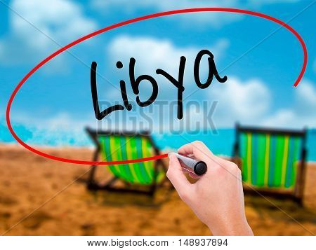 Man Hand Writing Libya  With Black Marker On Visual Screen