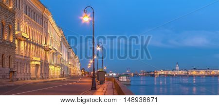 Night view of illumunated Palace Embankment and Neva River St. Petersburg Russia