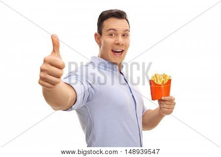 Happy man holding a bag of fries and giving a thumb up isolated on white background