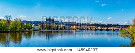Panorama view of Charles bridge over Vltava river and Gradchany Prague Castle and St. Vitus Cathedral in the Prague, Czech Republic