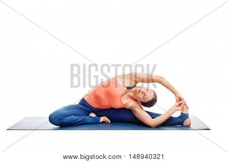 Beautiful sporty fit woman doing yoga asana parivrtta janu sirsasana - revolved head-to-knee pose posture isolated on white background