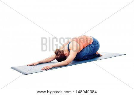 Woman doing Ashtanga Vinyasa Yoga relaxation asana Balasana - child posture - resting pose or counter asana for many asanas isolated on white background