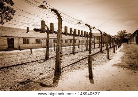 OSWIECIM POLAND - MAY 12 2016: Barbed wire surrounding concentration camp Auschwitz-Birkenau in Oswiecim Poland.