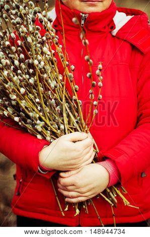Portrait Woman In A Red Jacket With A Huge Armful Of Willow In H