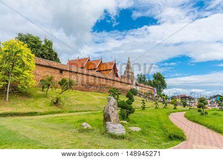 church and pagoda at phra tad lampang luang temple at Lampang province Thailand.