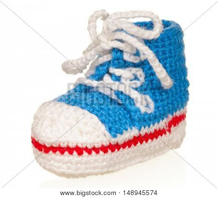 Handmade blue baby booties isolated on white background