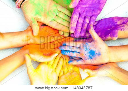 men's women's and children's hands in paint holy