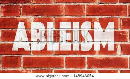 The Word Ableism Written On A Brick Wall